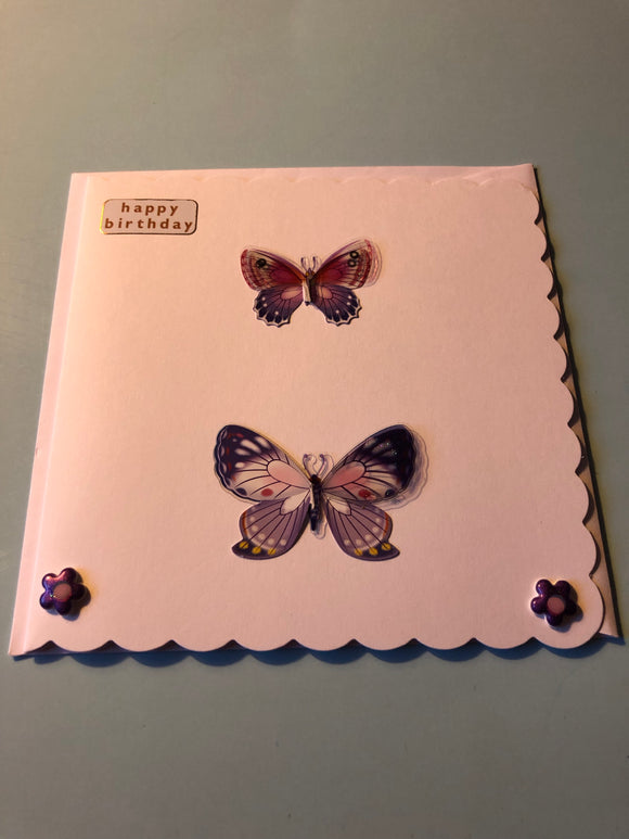 Women's butterfly with flowers birthday card