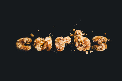 Carbs written with carbohydrates on a black background