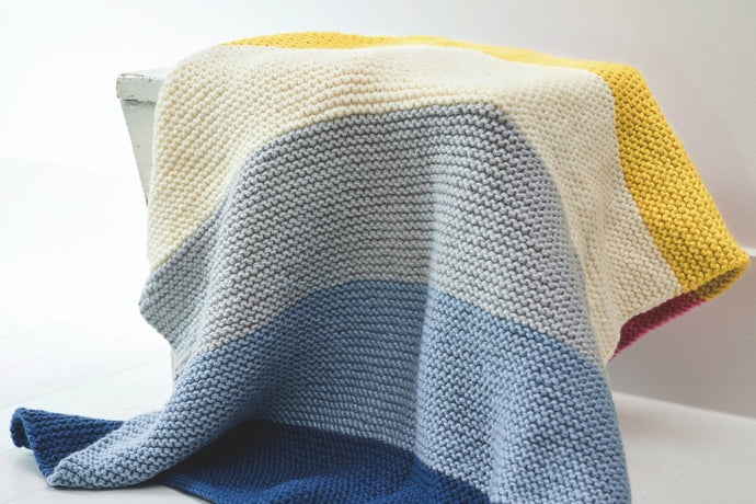 Knit a cosy striped blanket