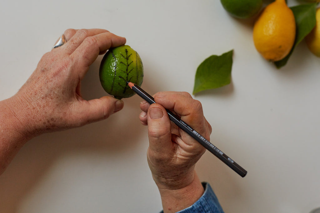 Draw on the lime with the pencil to mark the design