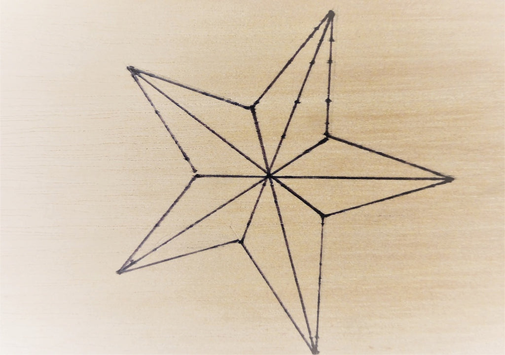 Trace the star pattern on wood