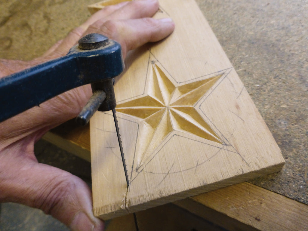 Cutting out the wooden star
