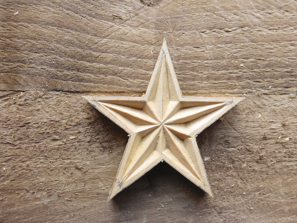 The cut-out wooden star