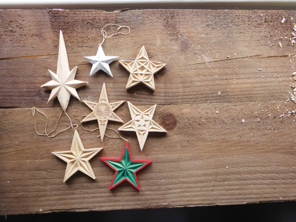 A variety of carved wooden stars