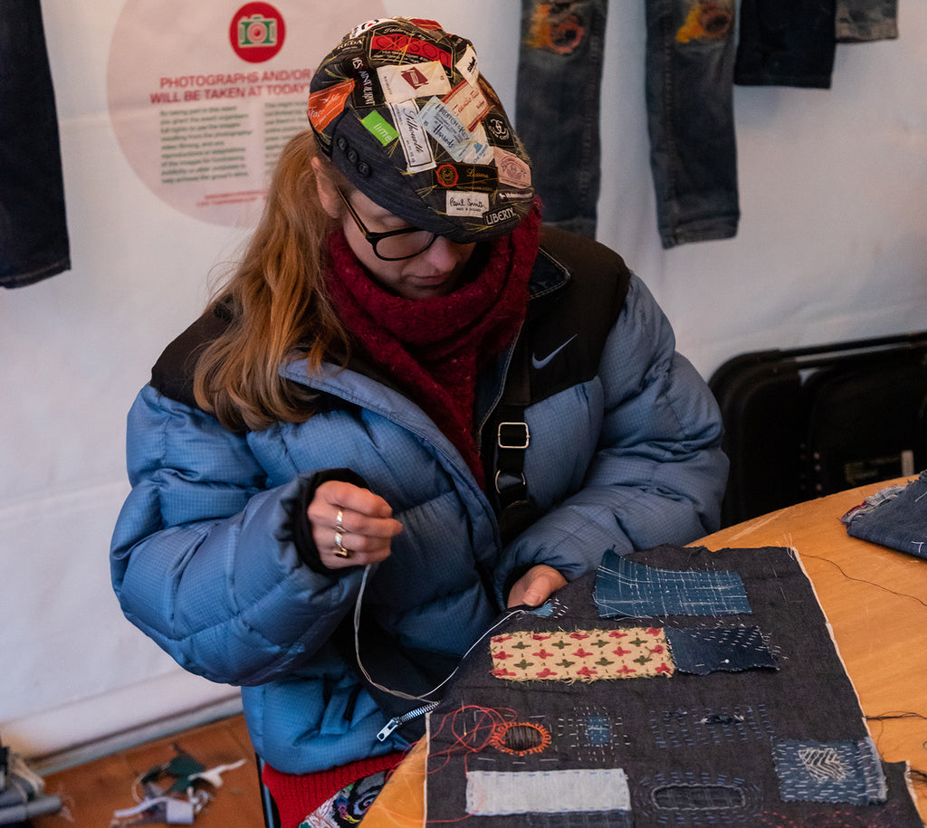 Barley Massey of Fabrications leads a workshop on visible mending using Sashiko-inspired techniques on denim.