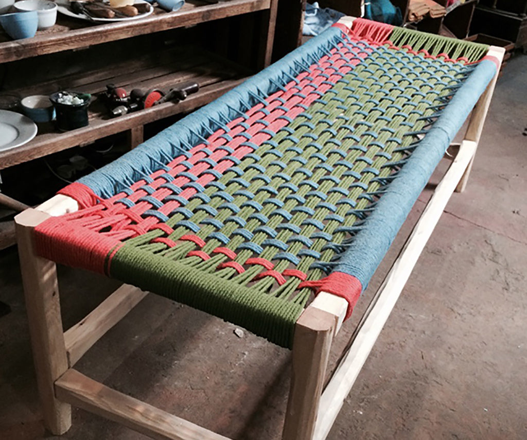 Woven table with red, green and dull blue.
