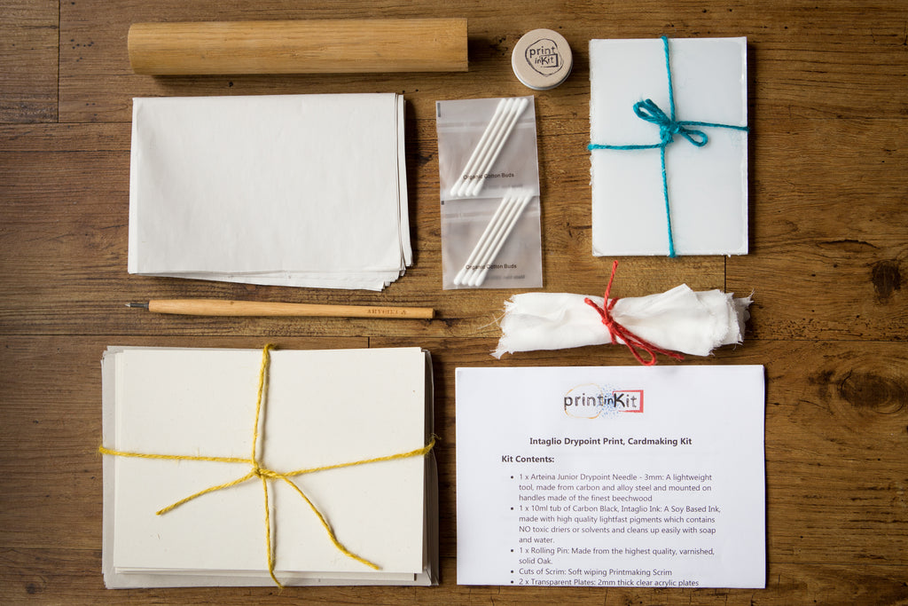 Printmaking kit laid out with every component, including tools and instructions, in a flatlay