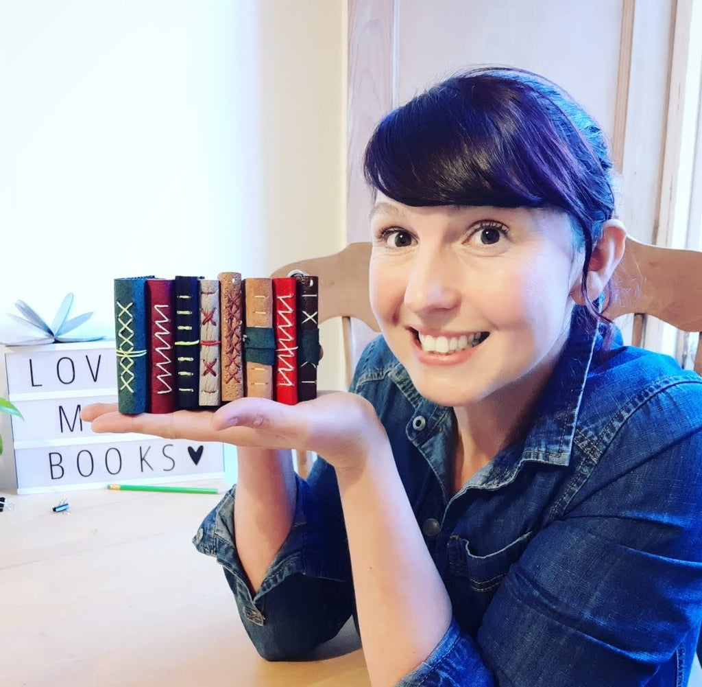 woman holding multiple books