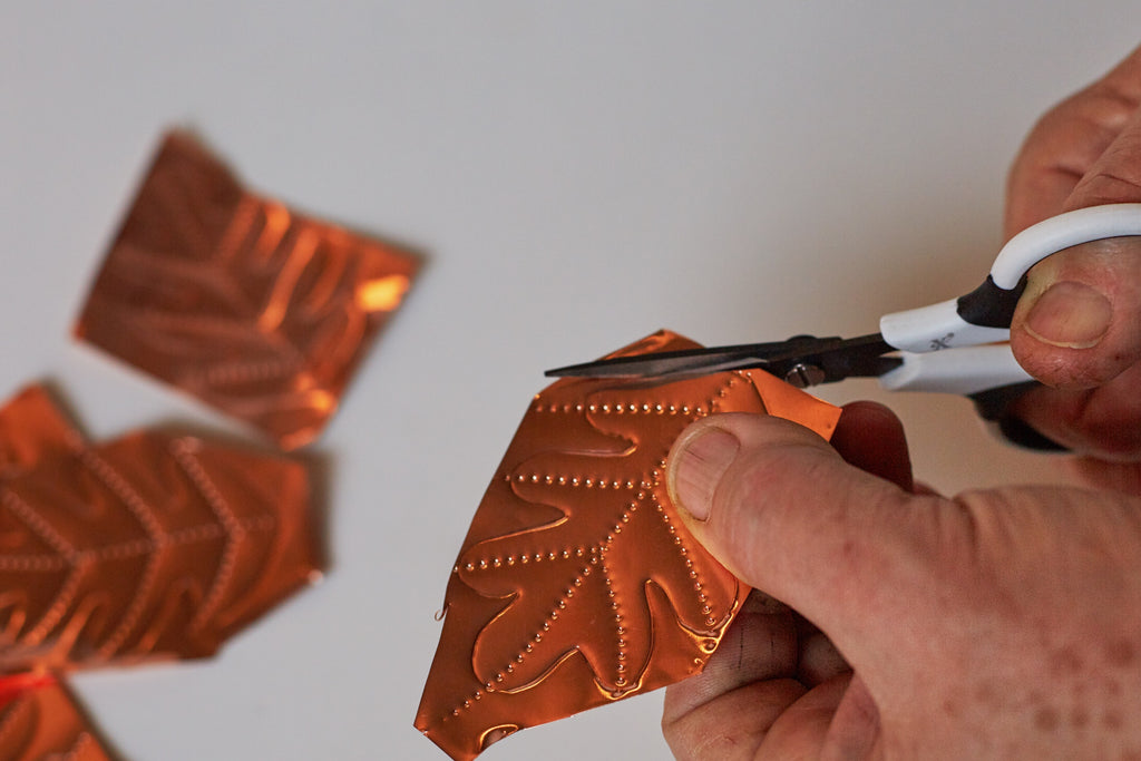 Cut copper leaves out