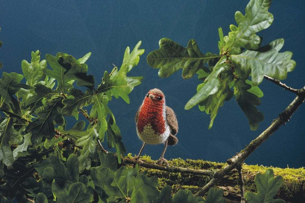 Crochet robin on a tree branch