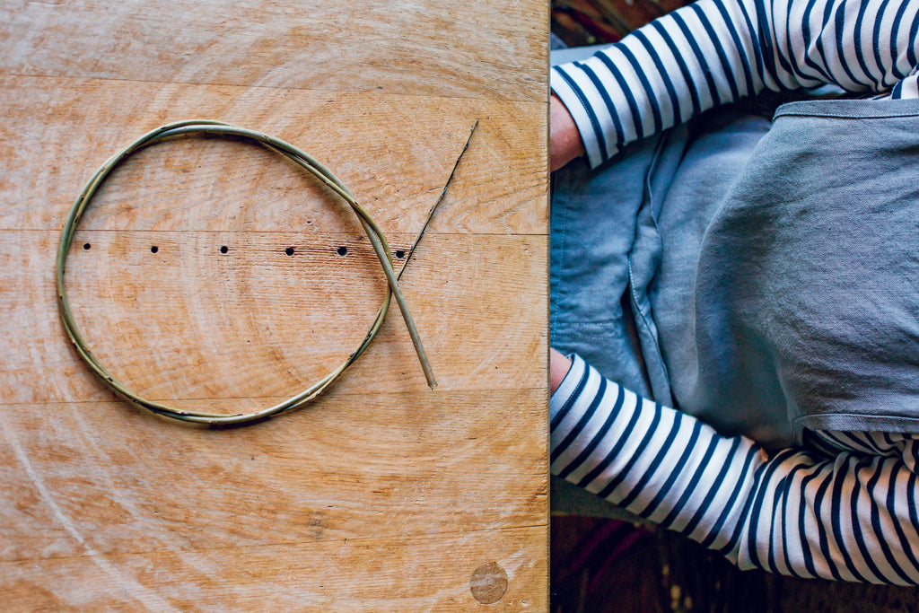 Looped cane on a table, overhead shot, person sitting next to it