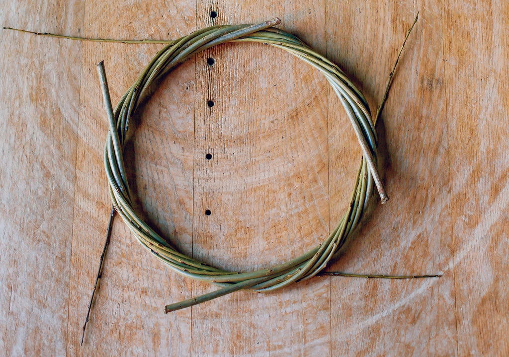 Willow wreath on its way to completion, laid flat on the table