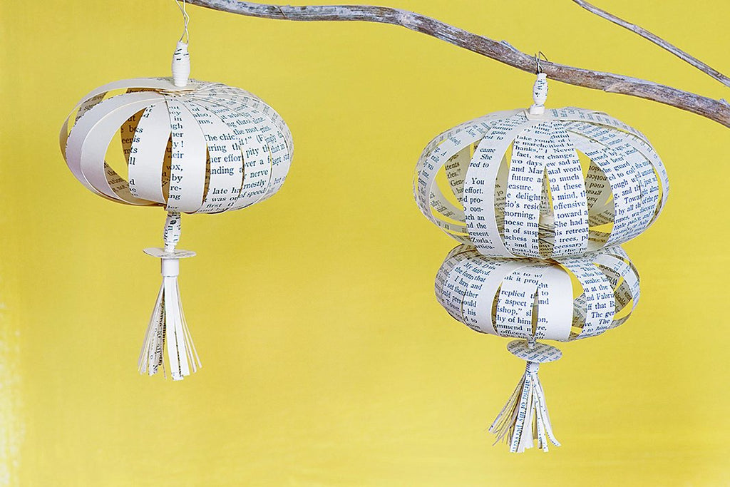 Make hanging paper tassel decorations using old books