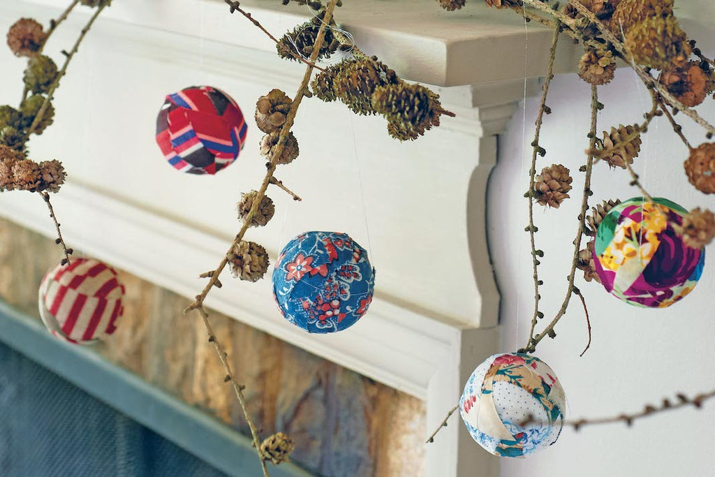 Fabric Chistmas baubles stylised on branches