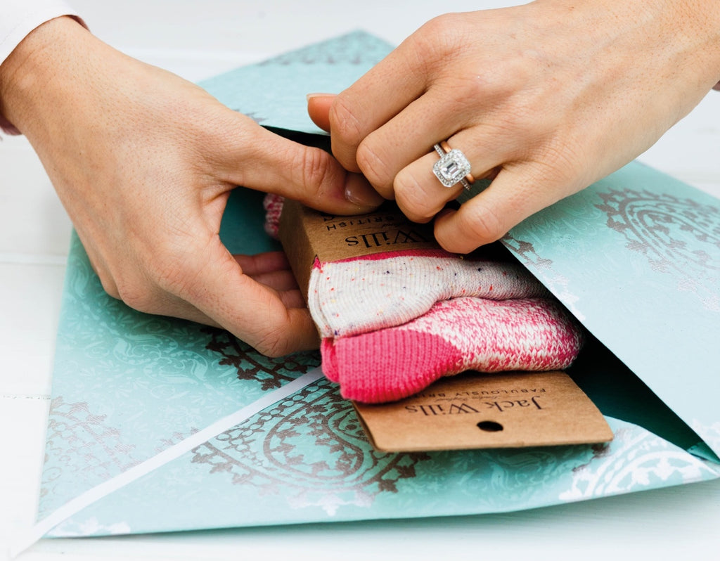 Placing socks inside the gift envelope
