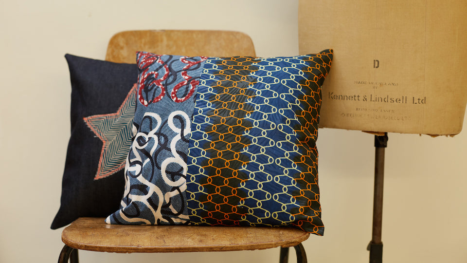 two cushions styled on a wooden chair