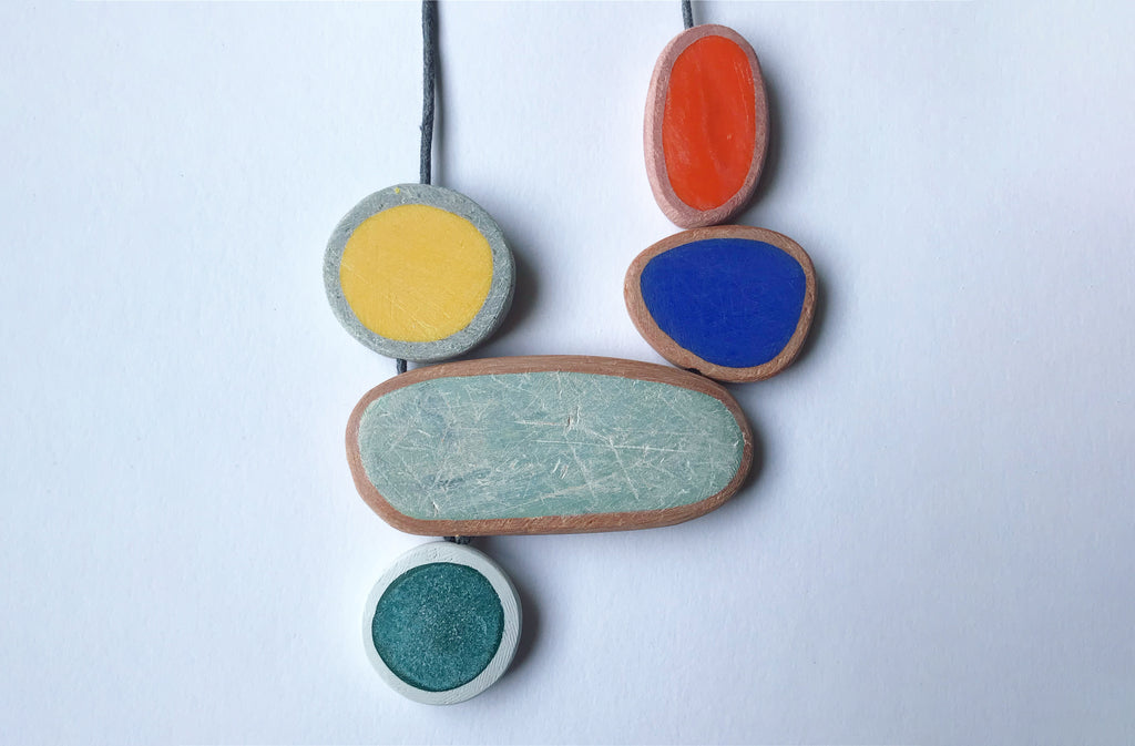 A pendant necklace with colourful, round and asymmetrical beads.