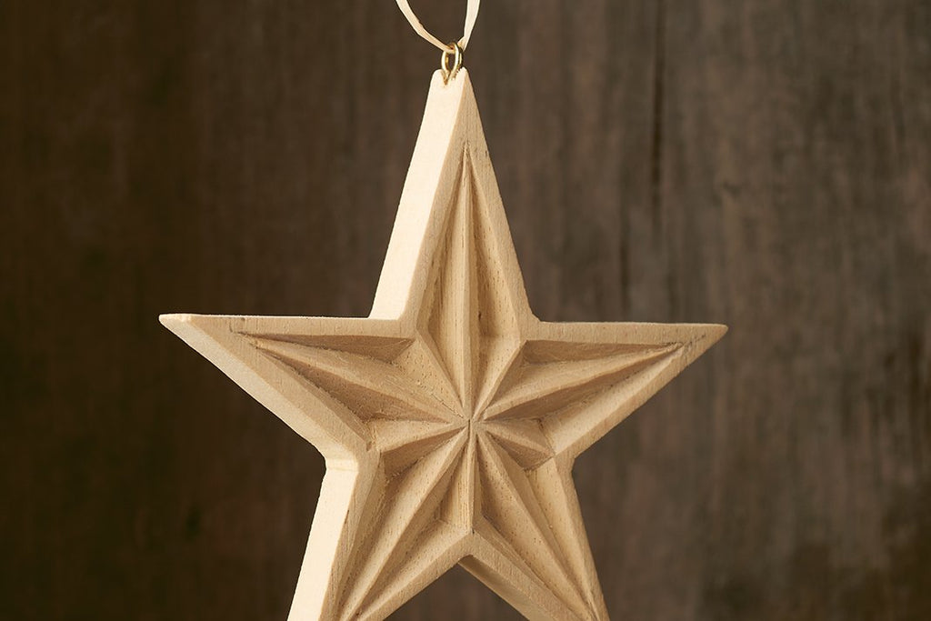 Finished carved wooden star