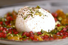 Load image into Gallery viewer, A burrata and burnt orange appetiser, sprinkled with pistachios, mint and pomegranate.