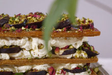 Load image into Gallery viewer, Detail of Fig and Rose Millefeuille, a Middle Eastern pastry layered with black figs and dried rose petals, pistachios, passion fruit and honey cream.