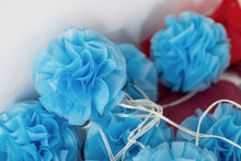 "Load image into Gallery viewer, A ""Kalinka"" traditional Polish pompom made with bright blue tissue paper."