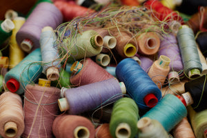 A pile of colourful thread spools.