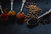 Load image into Gallery viewer, Spoonfuls of colourful and aromatic spices.