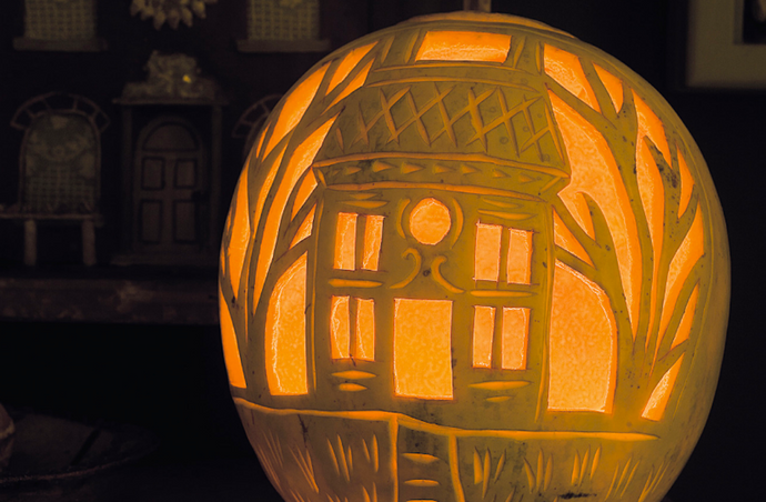 Create a 'house in the woods' pumpkin carving