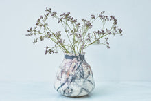 Load image into Gallery viewer, A smoke-fired ceramic vase with small purple flowers.