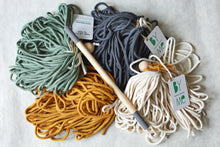 Load image into Gallery viewer, Macrame rope in four colours: eucalyptus, charcoal, mustard and natural cotton.