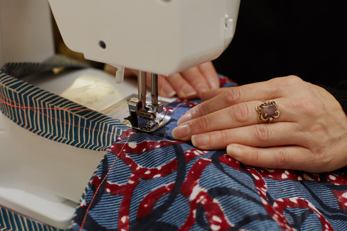 Detail of the process of sewing a reversible tote bag on a sewing machine.