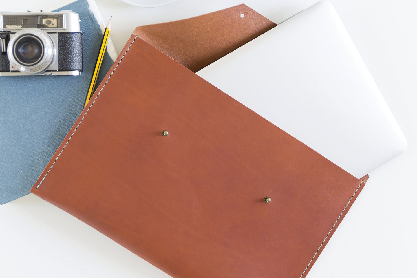 Learn to hand stitch a leather laptop case