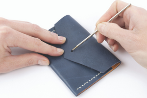 Learn to hand stitch a small leather purse