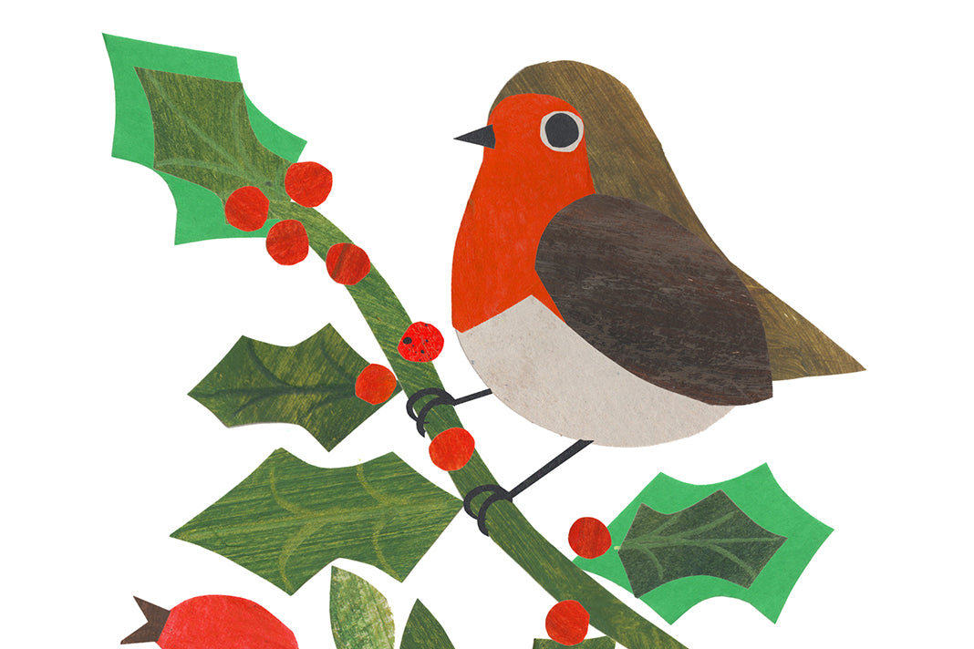 A festive robin made from a collage of cut-out paper.