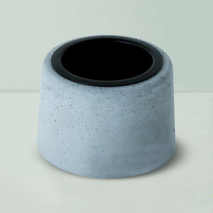 concrete round black metal planter grey