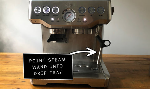 Pointing steam wand into drip tray