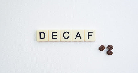 Decaf written in scrabble tiles - How is coffee decaffeinated