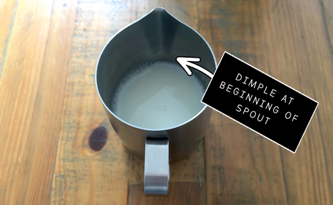 Where to fill the milk in the Barista Express jug