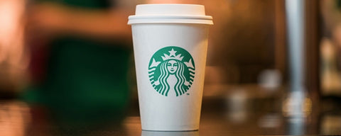 Starbucks caramel macchiato in a disposable cup