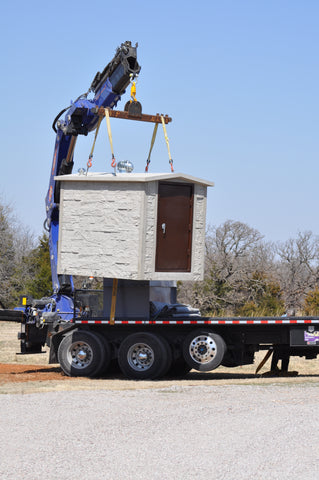 Using a crane to drop in a Concrete shelter