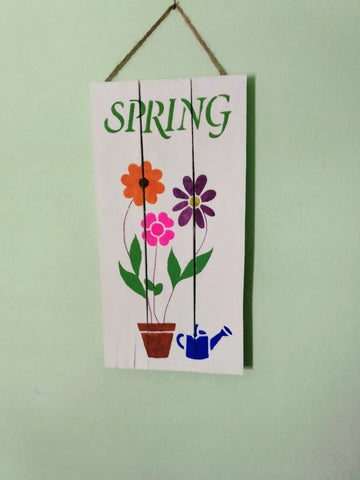 Spring pallet art hanging on wall