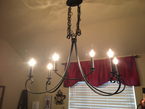 chandelier over pub table in kitchen