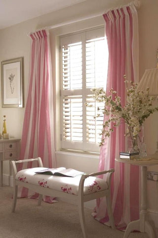 drapes flanking shutters