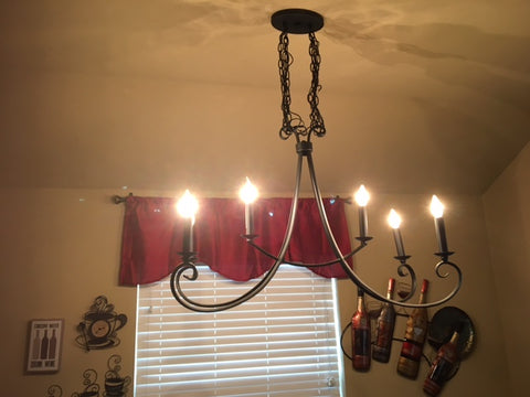 chandelier turned on in kitchen