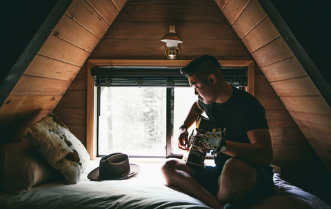 playing guitar in your wooden loft