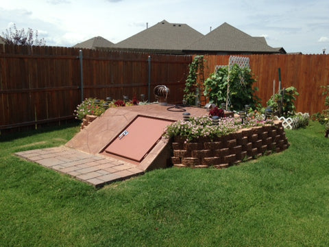 Backyard landscaped sloped storm shelter from Biggs