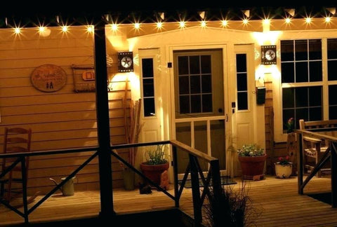 string lights and lamp on front porch refresh