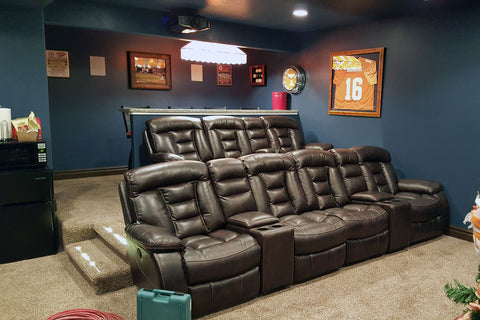 theater room with great seating and color