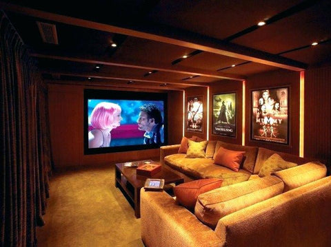 theater room with drapes and sectional