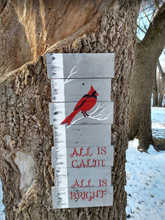 all is calm pallet sign hanging on tree